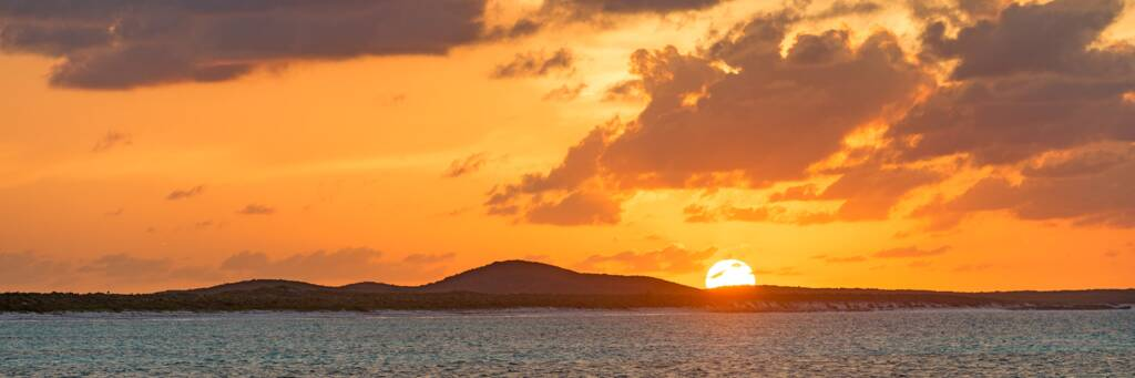 sunset over Flamingo Hill on East Caicos as seen from Breezy Point
