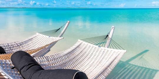 hammocks at the tranquil lagoon beach at Sailrock