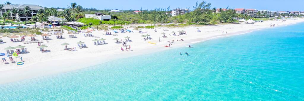 beach chairs and umbrellas at Grace Bay Beach in Turks and Caicos