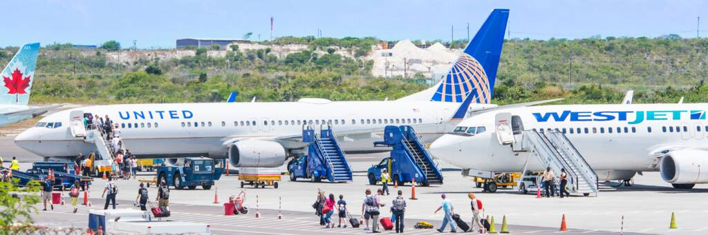 passengers boarding aircraft at the Providenciales International Airport