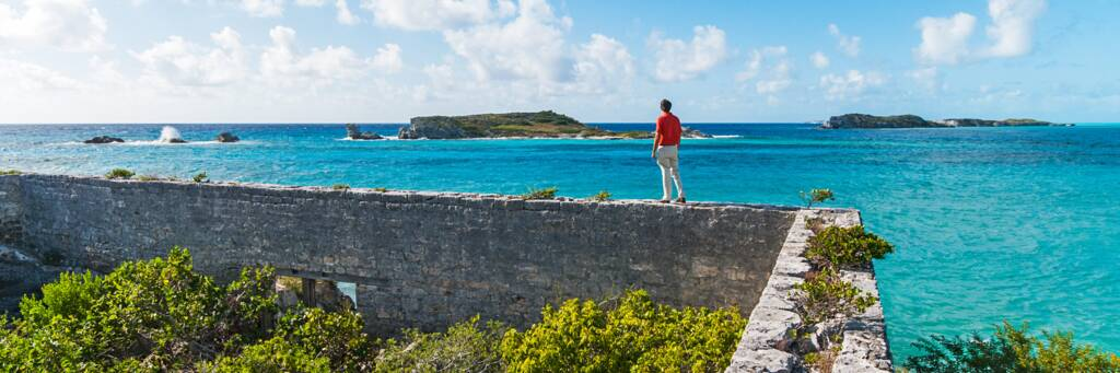 the foundation of a colonial building and the view of Long Cay from South Caicos