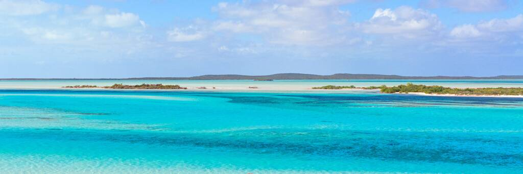 the incredible blue, turquoise and green water hues of Plandon Cay Cut in the Turks and Caicos