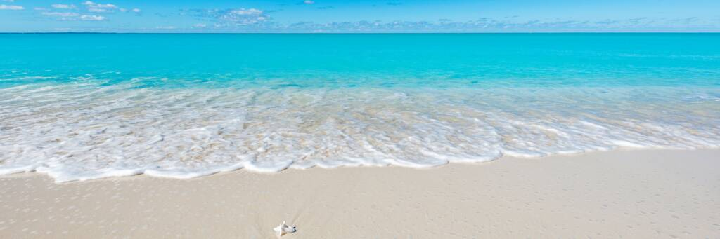 turquoise water and wave on the beach at Leeward on Providenciales