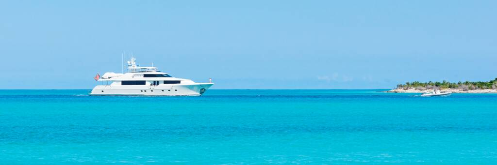luxury yacht arriving at Leeward Channel in the Turks and Caicos