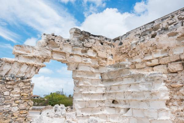 eroded limestone block wall at a colonial warehouse in Cockburn Harbour on South Caicos