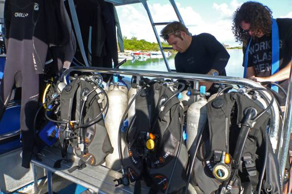setting up scuba diving equipment on a dive boat on Providenciales
