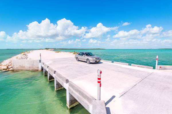 compact rental car on the concrete bridge of the North Caicos and Middle Caicos causeway