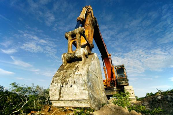 excavator at a construction site in the Turtle Cove region of Providenciales