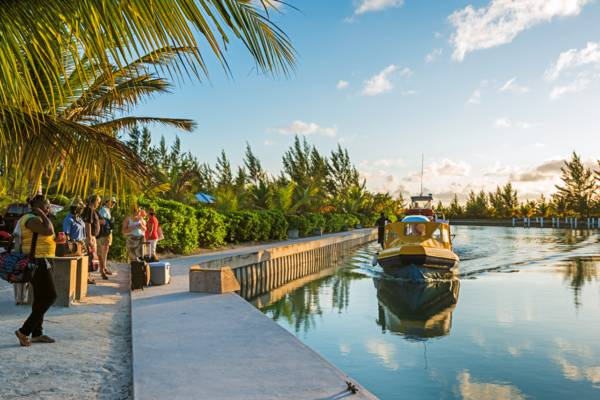 passenger ferry boat arriving at Sand Point Marina on North Caicos in the Turks and Caicos Islands