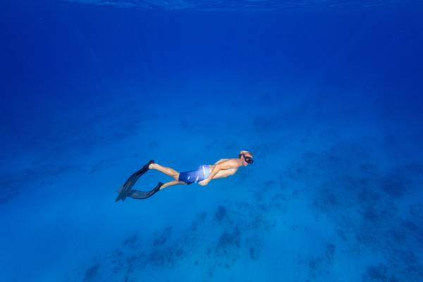 freediving in the amazing blue water of Malcolm's Road Beach