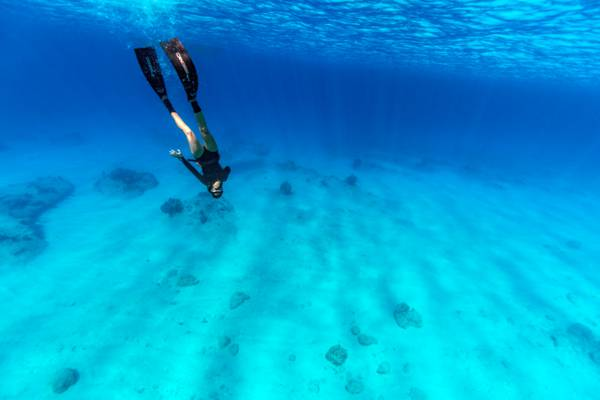 freediving in the beautiful ocean water of the Turks and Caicos Islands