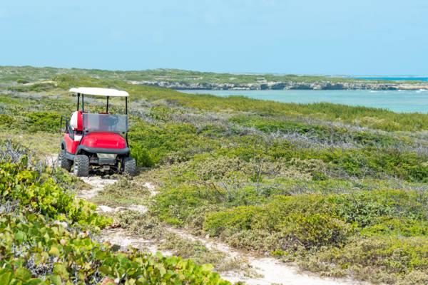 small trail with golf cart at the Long Bay coastal path