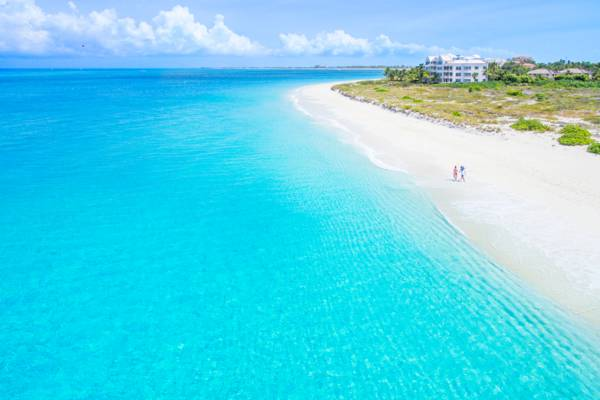 aerial view of two people walking on the secluded Grace Bay Beach in the Turks and Caicos