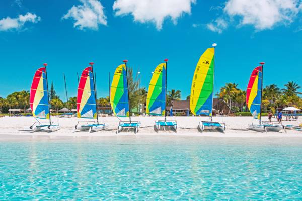Hobie Cats with colourful sails at the Club Med all-inclusive resort on Grace Bay
