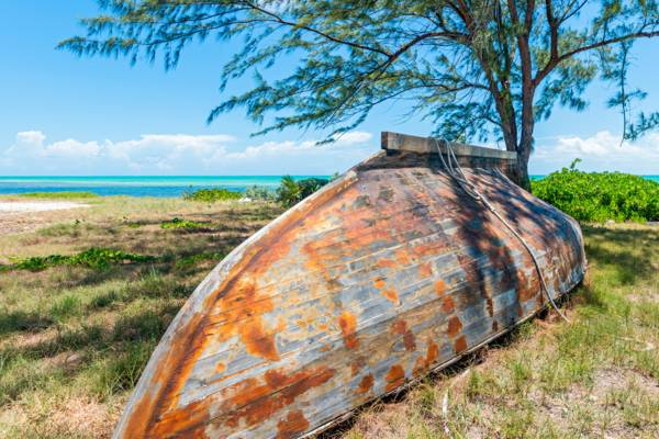 Caicos Sloop hull on the shore of Blue Hills on Providenciales