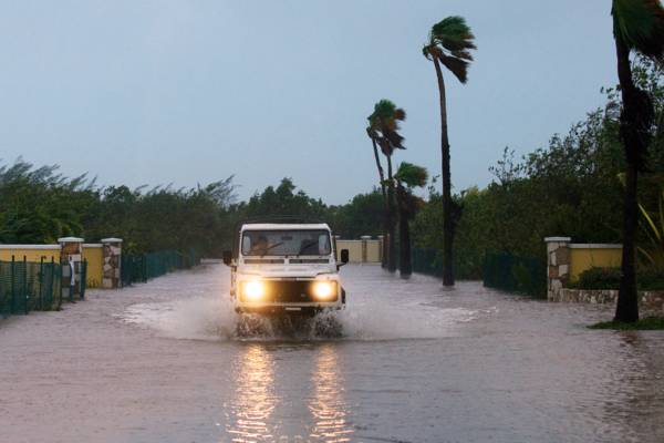Land Rover Defender wading through floodwater in the Leeward area of Providenciales