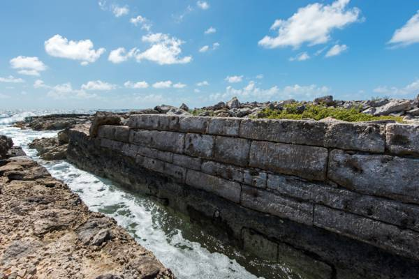 the limestone block wall at the inlet to the Grey Salina on Salt Cay