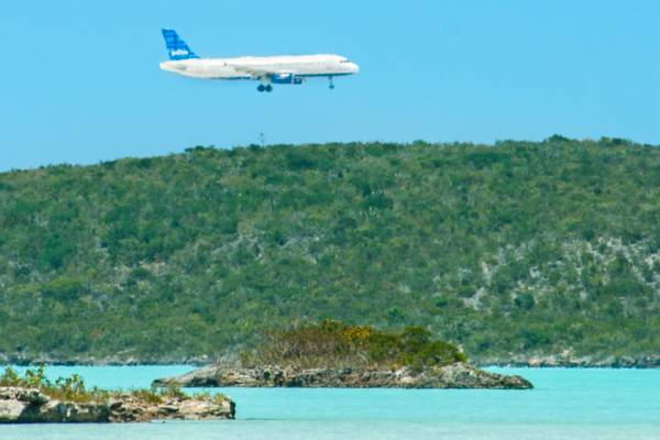 JetBlue Airbus A320 flying over Chalk Sound National Park on Providenciales