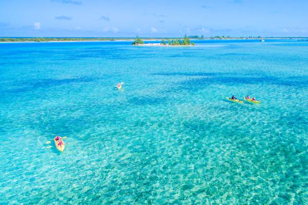 aerial view of kiteboarders in Leeward Going Through Channel off Providenciales