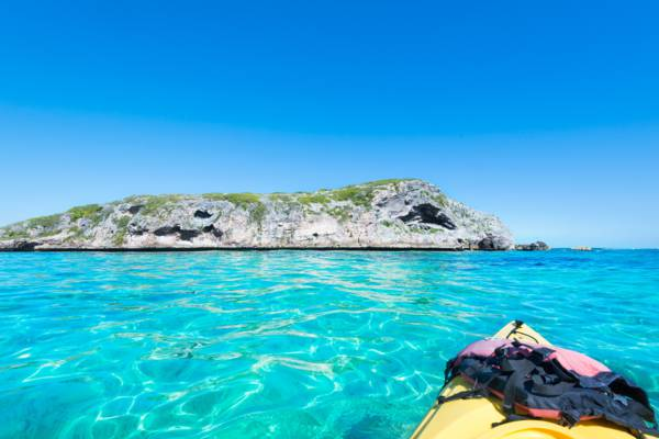 kayaking near a small flank margin cave on a rock near Middle Caicos