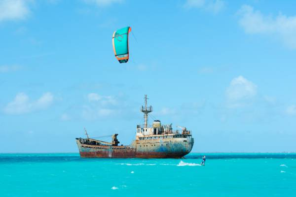 La Famille Express shipwreck and kiteboarder at Long Bay in the Turks and Caicos