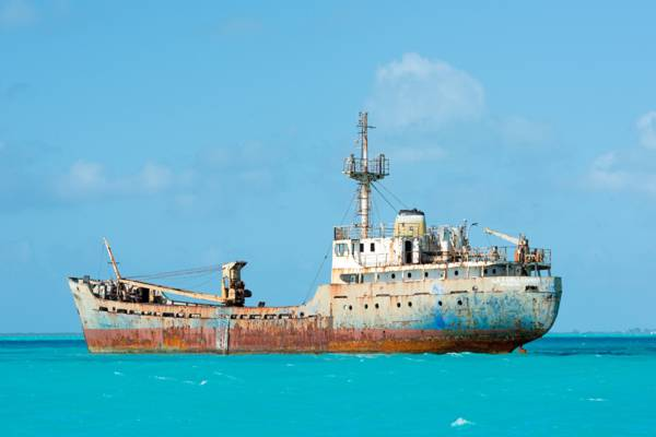the La Famille Express shipwreck in the turquoise ocean off Long Bay Beach in the Turks and Caicos