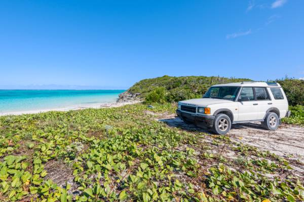 white Land Rover Discovery on the shore at Pumpkin Bluff Beach on North Caicos