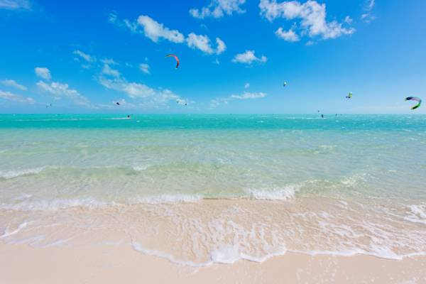 beautiful turquoise water and kiteboarders at Long Bay Beach in the Turks and Caicos