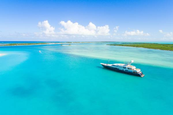 luxury yacht cruising through Leeward Channel near Providenciales in the Turks and Caicos