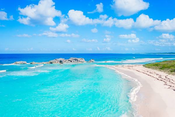 sparkling turquoise water and waves at Mudjin Harbour in the Turks and Caicos