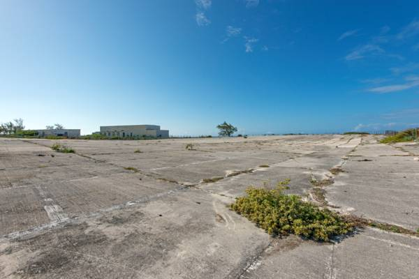 the expansive concrete rainwater collection field at the U.S. Navy NAVFAC 104 base on Grand Turk