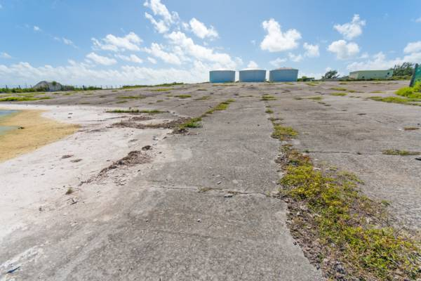 water storage tanks and the rainwater catchment field at the old U.S. Navy base on Grand Turk