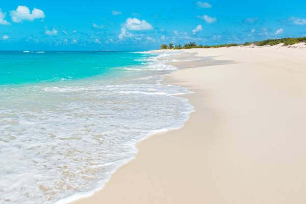 the turquoise Atlantic Ocean and white sand at North Bay Beach on Salt Cay