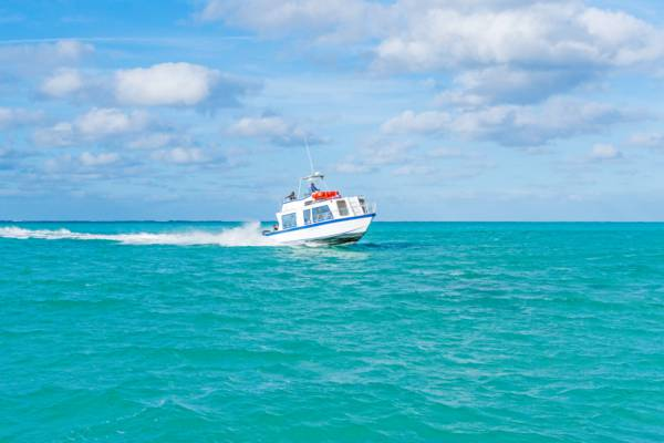 the Providenciales to North Caicos passenger ferry in the turquoise water of the Turks and Caicos