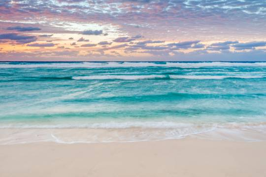 colourful sunset on the beach at the Northwest Point Marine National Park in the Turks and Caicos