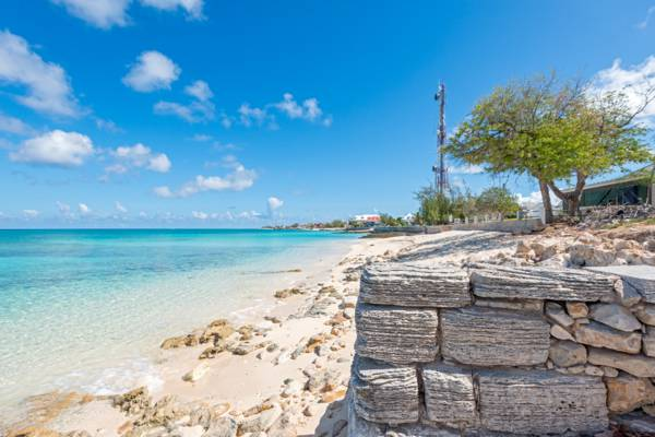 old limestone block wall on the beach at Cockburn Town on Grand Turk