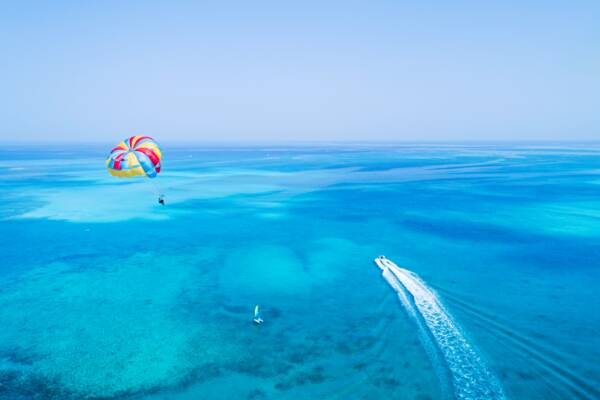 parasail and sailboat in the Turks and Caicos