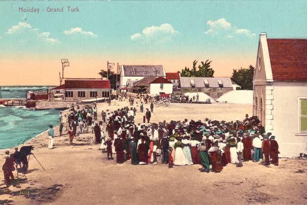 vintage photograph of a holiday gathering on Front Street in Cockburn Town, Grand Turk