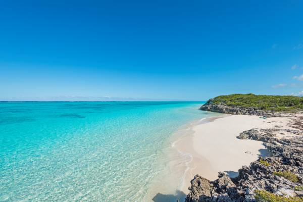 clear ocean water and the small beach at Pumpkin Bluff on North Caicos