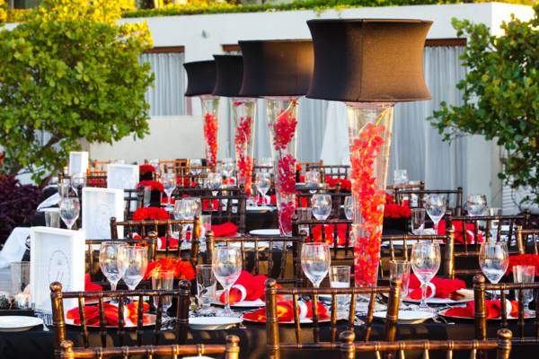 red flower place settings and decorations at a corporate dinner event in the Turks and Caicos