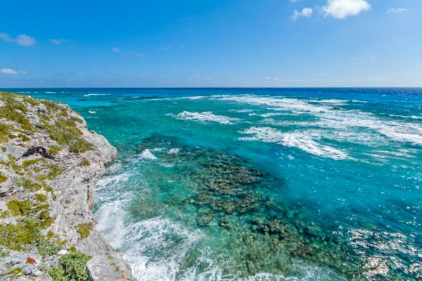 reefs and breaking waves off the coastal cliffs of the Highlands on South Caicos