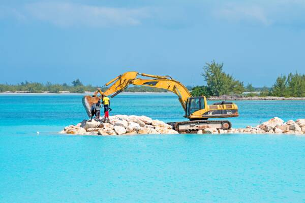excavator building a rock jetty at Leeward Beach on Providenciales
