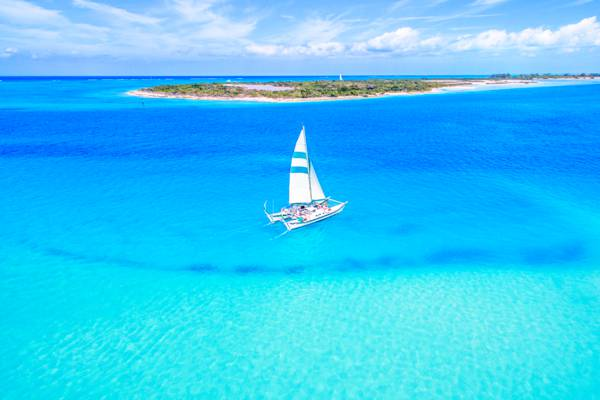 catamaran excursion boat sailing in the blue waters of the Turks and Caicos