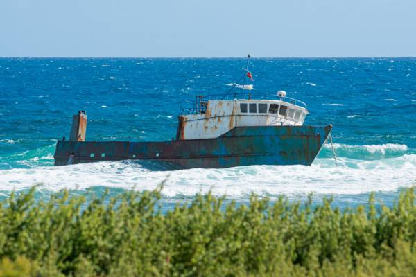 a Dominican transport ship grounded on the reef on the east coast of Salt Cay