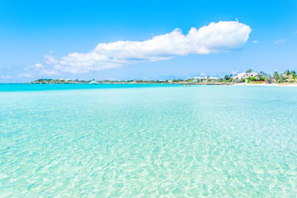 calm water and vacation villas at Sapodilla Bay Beach on Providenciales