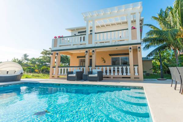 the swimming pool and exterior of Sea La Vie vacation villa at Long Bay on Providenciales