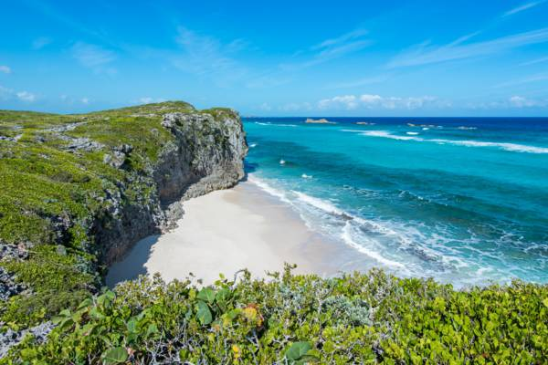 small beach hidden in the cliffs at Mudjin Harbour in the Turks and Caicos