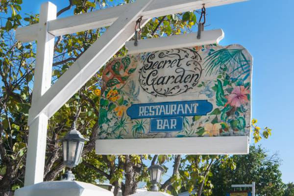 colourful sign for the Secret Garden Restaurant at the Salt Raker Inn in the Turks and Caicos