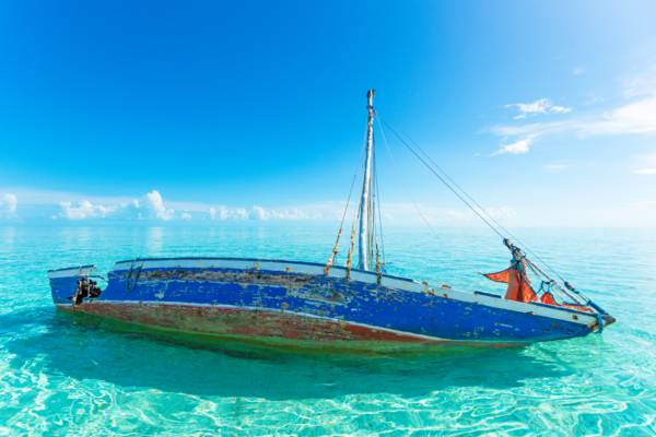 wrecked sloop in the shallow waters of the Caicos Banks