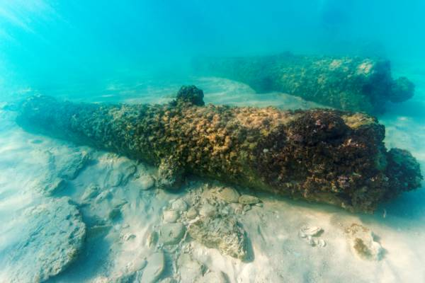 British 1700s cannons underwater at the site of Fort Saint George in the Turks and Caicos
